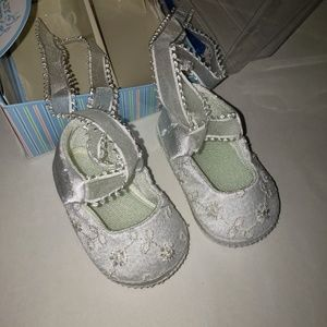 Baby deer.  White lacy baby shoes